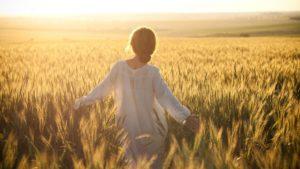 Girl-enjoying-in-fields-1920x1080